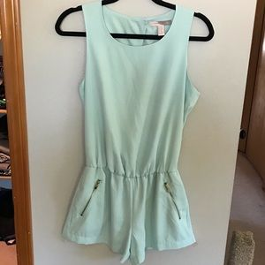 Mint romper with gold zipper pickets & wrap back